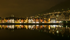 Golden Bergen  -  Bergen, Norway (N+C Photo) Tags: world old city travel vacation holiday reflection history tourism water norway night speed photography lights design casey photo nikon nadia europe long exposure slow image cloudy action earth expression north culture photographers historic unesco wanderlust adventure explore viajes artists wharf shutter getty noruega civilization geography traveling fotografia scandinavia visual explorers turismo vacaciones mundo bryggen travelers global gettyimages discover aventura tierra noorwegen d300 adventurers historico cp1 descubrimiento 2470f28 flickrcollection traveladventure urbansuburban gettyimagescom gettycollection mygearandmepremium nadiacaseyphotography