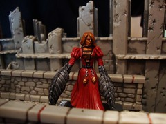 Decapitrix (ridureyu1) Tags: woman toy toys actionfigure miniature rpg mutant roleplayinggame stitched reddress dreamscape decapitation lobsterclaws fetishwear wizardsofthecoast wotc toyphotography dreamblade warpstrike sonycybershotdscw220 decapitrix mutantlady
