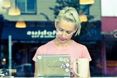 the grind (bluechameleon) Tags: street city urban woman color colour reflection cup window coffee lights cafe laptop scratches dirt eastvancouver explored bluechameleon artlibre sharonwish bluechameleonphotography