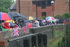 We love Britain and her weather (raggi di sole) Tags: england london rain river queen spectators pageant umbrellas riverthames vauxhall queenelizabeth catsanddogs britishweather jubliee diamondjubilee thamesdiamondjubileepageant nineelmsreach