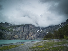 peak through clouds (nicolasheinzelmann) Tags: lake mountains berg juni clouds digital landscape schweiz switzerland see flickr fuji wolken peak berge fujifilm kandersteg aussicht landschaft x10 gipfel oeschinensee bewlkt fujifilmx10 fujinonasphericallens nicolasheinzelmann fujix10 10juni2012