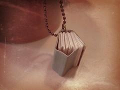 tiny book necklace for my niece (sandySTC) Tags: paper book miniature mini sew bookbinding binding handbound flickrandroidapp:filter=paris