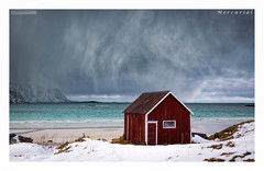 Mercurial (Stuart Leche) Tags: winter sea mountain snow storm beach norway clouds landscape rainbow sand rocks scenic turqouise shack 12 13 beachhuts lofotenislands boathose canon5dmkiii canonef24105mmf40lisusmlens norwegansea