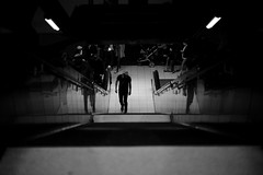 Don't go with the flow (maekke) Tags: urban bw man reflection architecture canon underground 50mm noiretblanc sweden stockholm availablelight f14 streetphotography symmetry tunnelbana 2016 eos6d