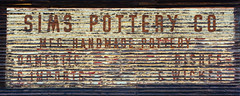 Sims Pottery Co. (davidwilliamreed) Tags: wood old sign typography decay rustic textures weathered peelingpaint distressed patina weatherbeaten
