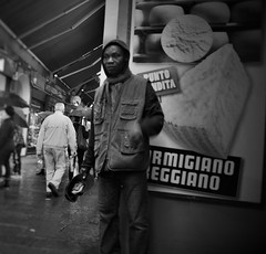 """Evocative"" (Mango*Photography) Tags: life street city people urban white man black love beautiful rain cheese contrast interesting contemporary streetphotography photographers places hidden human unusual reggiano humans touching giulia advertise parmigiano evocative bergonzoni giuliabergonzoni spacces"