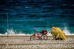 Absentee fishing (Melissa Maples) Tags: sea summer beach water bike bicycle umbrella turkey fishing nikon asia mediterranean trkiye antalya parasol nikkor vr afs fishingpole  rodandreel 18200mm  f3556g  18200mmf3556g d5100 konyaaltbeach