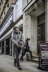 New medical condition........Mobile phone neck (tootdood) Tags: new mobile neck manchester phone candid piccadilly medical fromthehip condition streetcandid canon70d