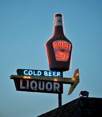 Bottle Shop Liquor (Rob Sneed) Tags: beer sign vintage advertising bottle twilight neon dusk liquor arkansas arrow liquorstore coldbeer texarkana nstatelineave