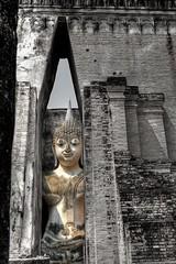 there is no fire like passion (JonBauer) Tags: sky monument asian religious temple site nikon asia buddha buddhist peekaboo columns buddhism thai southeast spiritual siam unescoworldheritage hdr highdynamicrange jataka photomatixpro mondop sukhothaihistoricalpark d700 kingdomofthailand 2470mmf28g phraachana watsichumchapel narrowslit