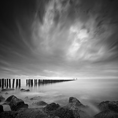 The Thin Line (Midnight - Digital) Tags: longexposure sea bw seascape holland water clouds pier blackwhite movement zeeland