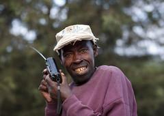 Man listening radio on road to Rehengeri - Rwanda (Eric Lafforgue) Tags: africa man smile radio outdoors rwanda afrika sourire commonwealth transistor oneperson homme footballmatch afrique headandshoulders eastafrica lookingatcamera centralafrica 9133 kinyarwanda ruanda afriquecentrale רואנדה 卢旺达 regardcamera 르완다 盧安達 republicofrwanda руанда رواندا ruandesa