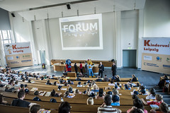 Children listen to a presentation at the Annual Summit in Leipzig