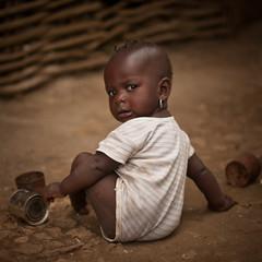 Hati 35/52: Grounded (PetterPhoto) Tags: poverty baby brown girl haiti kid child play ground nikkor nikkon milot 50mmf14g d300s petterphoto