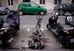 WTF Happened Here? Montmartre, Paris (ChrisGoldNY) Tags: street city travel urban paris france french funny europa europe european forsale humor eu motorcycles montmartre vehicles viajes posters vacations destroyed burned streetscenes bookcovers albumcovers pigalle carcasses sopi challengewinners thechallengefactory chrisgoldny chrisgoldberg chrisgold chrisgoldphoto chrisgoldphotos