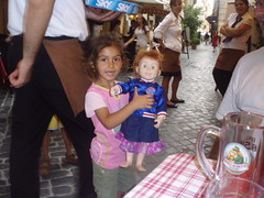 Passerby holding Jenna (begineerphotos) Tags: rome littlegirl girlwithdoll
