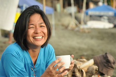 Morning Coffee (Gilbert Rondilla) Tags: ocean camera morning travel sea people woman color beach coffee smile lady female digital children mom asian 50mm nikon child philippines young mother shore aurora gilbert filipino nikkor motherhood pinoy baler 18d nikkorlens d90 50mm18d rondilla nikond90 gilbertrondilla gilbertrondillaphotography luisianian gettyimagesphilippines gettyphilippinesfamily