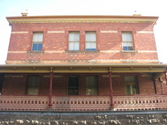 The Former Ballarat Police Station and Barracks - Camp Street, Ballarat (raaen99) Tags: city windows roof chimney building brick window stone architecture facade iron balcony wroughtiron pillar 19thcentury victorian australia victoria victoriana column elevated verandah residence policestation lawandorder 1886 ballarat goldrush bluestone victorianarchitecture balustrade redbrick eave nineteenthcentury fretwork 1880s countryvictoria campstreet policedepartment civicbuilding constabulary lacework policeforce victorianbuilding clinkerbrick policebarracks campst doublestorey goldrushera brickandstone provincialvictoria wroughtironlacework wroughtironfretwork wroughtironbalustrade featurebrick bluestonepitcher ballaratpolicestation ballaratpolicebarracks