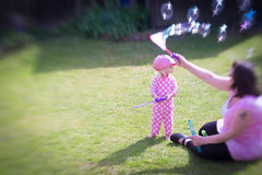 Star Wand (Simon in Southend) Tags: pink light summer people blur cute green love girl beautiful grass lensbaby garden stars fun star kid aperture focus toddler infant child bright little bokeh wand sony daughter creative sunny bubbles bubble mummy alpha shape sel lensbabies starz 6000 composer petit selective facination optic childlike a6000 emount seeinanewway ilce6000