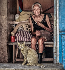 Cigarette and a pet (FotoGrazio) Tags: poverty portrait people woman pet art animal composition cat fur asian photography eyes feline photoshoot cigarette philippines poor streetphotography streetportrait streetscene smoking elderly portraiture oldwoman pinay filipina moment photographicart capture digitalphotography ilocosnorte sandiegophotographer artofphotography flickrelite californiaphotographer internationalphotographers worldphotographer photographersinsandiego fotograzio photographersincalifornia waynegrazio waynesgrazio