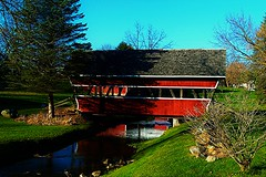 Welcome to Mill Creek (SCOTTS WORLD) Tags: bridge november blue light shadow red sky sunlight reflection building green fall water grass leaves architecture rural america creek fun midwest scenery angle pov michigan hill perspective may bluesky historic panasonic adventure coveredbridge hadley 248 2016 2015 lapeer