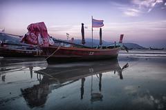 Dawn at the beach in Phuket (Pat Charles) Tags: ocean morning travel reflection tourism beach water sunrise reflections thailand dawn boat fishing nikon asia flag reflected phuket 1001nights