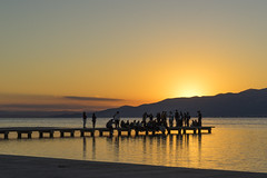 Worship (dlorenz69) Tags: light sunset people water river licht spain worship jetty delta menschen spanien steg ebre admire anbeten terradelebre