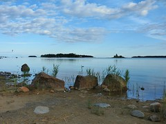 Triplets (KaarinaT) Tags: blue summer water clouds finland islands evening still helsinki sand rocks rocky baltic serene seashore gulfoffinland vuosaari bluesea kallahti