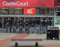 I wonder who's going to get the top bargains.. (teedee.) Tags: big riot cops sale police gear belfast castlecourt psni