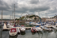 Torquay Harbour and Torquay Eye (Howie Mudge LRPS) Tags: boat yacht torquay water sea wheel eye sky clouds harbour buildings hotels tourism travel travelling outside outdoors overcast cloudy day devon england sony rx100iv compactcamera pointandshoot