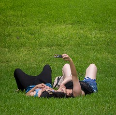 (heatherbirdtx) Tags: cameraphone park color green grass composition couple outdoor pov availablelight candid strangers overcast crop stolen lay selfie