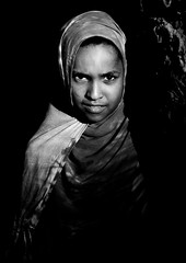 A Young Girl's Portrait, In The Half Light Of Dusk, Lamu, Kenya (Eric Lafforgue) Tags: africa island blackwhite pretty kenya islam culture unescoworldheritagesite teenager afrika tradition lamu concerned swahili afrique mocking hateful adolescence eastafrica qunia lamuisland lafforgue oneteenagegirlonly africanethnicity onegirlonly  qunia islamicveil    kea 1415years   tradingroute 111151 a