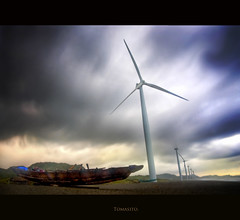 Bangui Windmills (Tomasito.!) Tags: ocean longexposure sea vacation sky storm beach nature beautiful clouds indonesia asian th