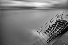 Three Steps Below (Anthony Owen-Jones) Tags: uk longexposure sea blackandwhite cloud white seascape black art water monochrome wales clouds stairs canon landscape rebel mono coast landscapes photo seaside kiss long moody artistic unitedkingdom fineart picture gimp minimal photograph le ethereal nd postprocess minimalist bnw hoya t3i x5 rhosonsea colwynbay canonefs1022mmf3545usm rhos colwyn sep2 600d takenwith 10stop nd110 nd16 rebelt3i kissx5 anthonyowenjones anthonyowenjonescom