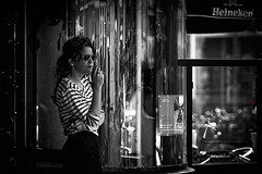 The Break (Jeff Krol) Tags: street city blackandwhite bw woman cinema window glass monochrome amsterdam contrast canon reflections hair heineken outside person eos noir break dof bokeh candid stripes streetphotography smoking ring curly pause cinematic blanc f28 2012 filmnoir 70200mm 70200l ef70200mmf28lusm img7056 60d canon60d sunflasses jeffkrol