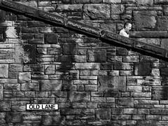 Old Lane (Peter.Bartlett) Tags: street city people urban blackandwhite man monochrome wall pen mono blackwhite candid yorkshire streetphotography olympus nik halifax olympuspen westyorkshire blackdiamond ep3 streetphotographyurban oldlane niksilverefex microfourthirds