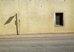 ohne bus. (sic) Tags: street shadow urban window station sign facade germany traffic urlaub snapshot front german bleak asphalt sonne trist reise brgersteig irgendwo sddeutschland vorfahrt