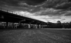 (drfugo) Tags: bridge trees light sunset summer sky bw plants sun white black field clouds contrast concrete spring motorway farm crop canon5d rays shoots pillars railings supports m23 sigma28mmf18exdg