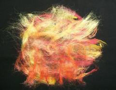 Reds, oranges and yellows (zedster01) Tags: felting silk tussahsilk ironing silkpaper starch fibrepaper mulberrysilk feltingsupplies silkthrowaterswaste
