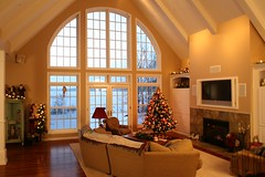 Great Room with a View (North Twin Builders) Tags: christmas wood windows winter summer white house lake drywall wisconsin fire design tv construction fireplace floor interior christmastree livingroom couch entertainment decorating loveseat eagleriver upnorth stgermain contractor wi lightfixture phelps cabinets entertainmentcenter northwoods conover decorated greatroom kolbe builtin landolakes threelakes customhome vilascounty northernwi lakehome entertainmentcabinet custombuilder recessedcans paintedtrim northtwinbuilders