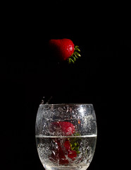 Three Strawberries? (Area256) Tags: red dark strawberry flash multipleexposure wineglass highspeed strobe canon60d cactustriggers canonef100mmf28lmacroisusm cactusv5