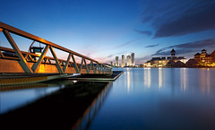 Golden Jetty (Tan Andy (Sorry if I did not reply)) Tags: longexposure morning blue lake building water architecture landscape gold dawn hotel golden jetty calm pullman malaysia kualalumpur putrajaya d300s nikkor1024mm