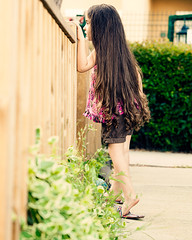 CeyLin-Looking Over the Fence (E.L.A) Tags: summer portrait plant cute childhood vertical standing fence turkey outdoors photography day loneliness child looking fulllength longhair happiness security istanbul safety innocence littlegirl curious sideview brownhair casualclothing colorimage 45years supershot abigfave