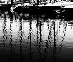 Masts (Demmer S) Tags: sea blackandwhite bw lake reflection water monochrome lines sailboat port marina reflections boats outside outdoors reflecting harbor pier boat blackwhite marine sailing ship waterfront yacht sails reflected reflect sail reflective ripples mast sailboats masts bnw lakefront blackwhitephoto calmwater boatlife blackwhitephotos