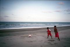 * (-nasruddinmukhtar-) Tags: beach seaside kid soccer shoreline malaysia footbal kelantan contaxt2 bachok carlzeisssonnart38mmf28 nasruddin nasruddinmukhtar efinitisuperuxi200 pantaitokchong