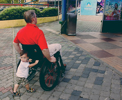 Copyright  Esraa photography | 2011 (Esraa | ) Tags: city boy wheel by wagon fun parents condemned child affection wheelchair father small grandfather have disabled per ones  isra honoring  ihsan        my i condemns  esraa               alkhuzaim alkhozim