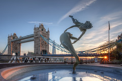 Girl with a Dolphin (TheFella) Tags: uk greatbritain bridge sunset england sky sculpture sun slr london fountain girl statue clouds digital photoshop towerbridge canon eos evening photo high europe dynamic unitedkingdom dusk dolphin capital photograph processing gb 5d rays dslr range hdr highdynamicrange starburst markii postprocessing towerhotel towerhamlets photomatix davidwynne girlwithadolphin thefella 5dmarkii conormacneill thefellaphotography