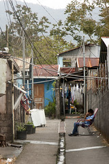 Costa Rican Backalley (Viking-) Tags: poverty life street houses boy home kid alley costarica sitting backalley child powerlines tired thinking pondering arenal lafortuna