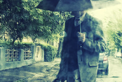 Rain in May (Rambynas) Tags: street city window rain umbrella kaunas passer