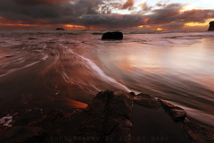 Muriwai (Ashley Daws) Tags: ocean new sunset sea sky west beach water rock clouds flow auckland zealand nz muriwai